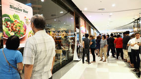 People in que wating a front of Sizzler at Central west gate Royalty Free Stock Photo