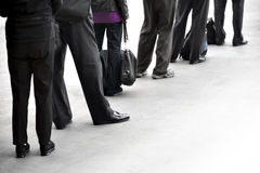 People in queue. People in dark clothes with bags waiting in queue Royalty Free Stock Photos