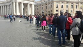 People in queue by the famous Bernini Colonnade, waiting to enter and visit St Peter`s Basilica. Rome, italy - March 2017: People in queue by the famous Bernini stock footage