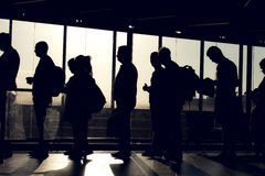 People on queue with silhouette. People are waiting in the aterminal with their silhouette reverse lighted image Royalty Free Stock Photo