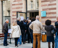 People queue to vote in the first round of the French presidenti. STRASBOURG, FRANCE - APR 23, 2017: People queue to vote in the first round of the French stock image
