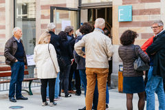 People queue to vote in the first round of the French presidenti. STRASBOURG, FRANCE - APR 23, 2017: People queue to vote in the first round of the French royalty free stock images