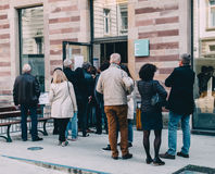 People queue to vote in the first round of the French presidenti. STRASBOURG, FRANCE - APR 23, 2017: People queue to vote in the first round of the French stock photo