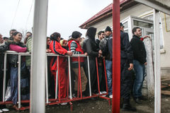 People queueing to cast the vote. Cretesti, Ilfov County, Romania, December 6, 2009: People standing in a queue to vote in Cretesti, Ilfov County royalty free stock photos
