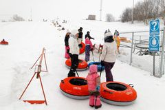 People queueing to go sliding in Rimouski, Quebec royalty free stock image