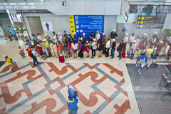 People queuing at the airport Royalty Free Stock Image