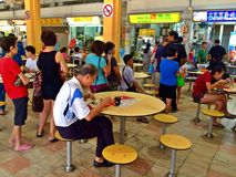 People queuing in hawker centre Stock Images