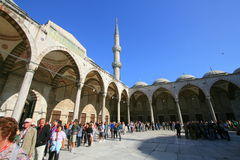 People queuing in mosque courtyard. Tourists queuing to see the Sultan Ahmed or Blue Mosque in Istanbul in Turkey Stock Images