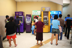 People queuing to withdraw cash in ATM. BANGKOK, THAILAND - AUGUST 02, 2014: Unidentified people queuing to withdraw cash in ATM machine. Queue to use ATM is Royalty Free Stock Images