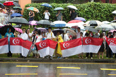 People queuing up to pay last respect to ex prime minister of Singapore Me Lee Kuan Yew. SINGAPORE - MARCH 29:Thousands of people queuing up in heavy rain to pay Royalty Free Stock Photo