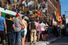 People Queuing for World Pride Event. TORONTO, CANADA - 26TH JUNE 2014: Large amounts of people queuing to get in to an event down Church for World Pride Stock Photos