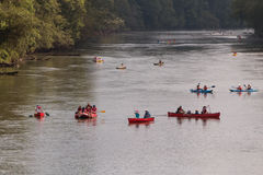 People Raft And Canoe Down River On Hot Summer Day Stock Photography