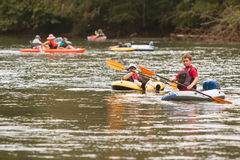People Raft And Kayak Along River On Hot Summer Day Stock Photography