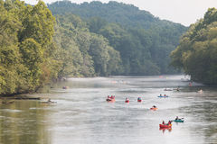 People Raft And Kayak Down River On Hot Summer Day Royalty Free Stock Photography
