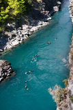 People rafting along the river. Rafting along one of many mountain streams in Central Otago, New Zealand royalty free stock image
