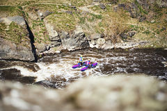 People rafting river rapids. Extreme tourism. Royalty Free Stock Photography