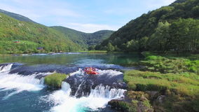 People rafting on waterfalls of Una river in Bosnia stock video footage