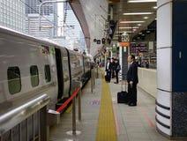 People at railway station in Tokyo, Japan royalty free stock image