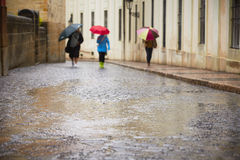 People in rain Stock Images