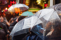 People with rain umbrellas in the rainy city. Crowd of people with rain umbrellas in the rainy city Royalty Free Stock Photography
