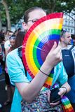 People with rainbow objects and flags. MADRID, SPAIN - JULY, 6: People wearing and carrying rainbow objects and flags at the Gay Pride parade. Near 1,200,000 royalty free stock photo
