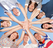 People raise hands across sky Royalty Free Stock Photography