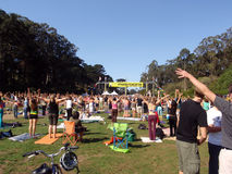 People raise hands into the air doing yoga Stock Photo