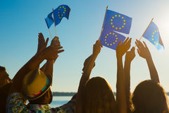 People with raised hands waving flags of the European Union. Royalty Free Stock Photography
