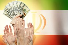 People raising hands with dollars and flag Iran on background. Patriotic concept royalty free stock image