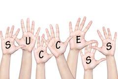People raising hands to celebrate success. Success of team work - people raising hands Royalty Free Stock Photo