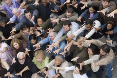 People Raising Hands Together Stock Photo