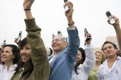 People Raising Mobile Royalty Free Stock Image