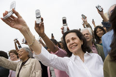 People Raising Mobile Phone Royalty Free Stock Photos