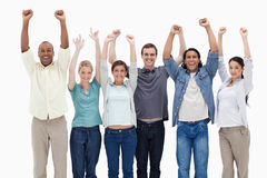 People raising their arms. Against white background Stock Photo