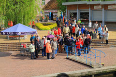 People at the ramp before the trip on a yacht. MIKOLAJKI, POLAND — MAY 10, 2014: People at the ramp before the trip on a yacht Stock Photo