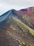 People on range between craters on Mount Etna Stock Photography