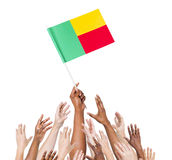 People Reaching For The Flag Of Benin Royalty Free Stock Photos