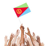 People Reaching For The Flag Of Eritrea Stock Image