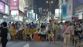 People read the article at Umbrella Revolution in Monkok, Hong Kong Stock Photos