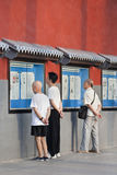 People read newspaper outside, Beijing, China Stock Image