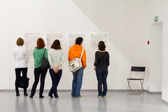 People reading interview at the exhibition Royalty Free Stock Images
