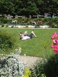 People reading lying on the grass Royalty Free Stock Photo