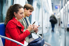 People reading news with phones Royalty Free Stock Images