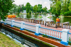 People are ready to rent a boat in Moscow Gorky park. Moscow, Russia. 24th May 2014: People prepare themselves to rent a hidrocycle at Golitsyn pond of Moscow Stock Image