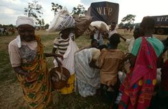 People receiving food supplies from the WFP Stock Photo