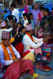 People receiving Rakshya Bandhan from the Brahmin Priests on Jan. Hindus in Nepal and elsewhere were celebrated Janai Purnima on Friday. On this day, men from royalty free stock photo
