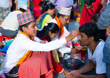 People receiving Rakshya Bandhan from the Brahmin Priests on Jan. Hindus in Nepal and elsewhere were celebrated Janai Purnima on Friday. On this day, men from stock images