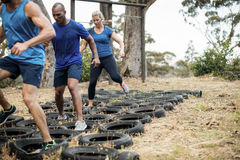 People receiving tire obstacle course training stock photos
