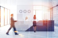 People in reception hall of white office royalty free stock photography