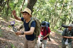 People record himself doing hiking. With friends in the wood Stock Image